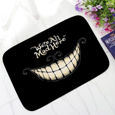 """We're All Mad Here"" Printed Doormat"